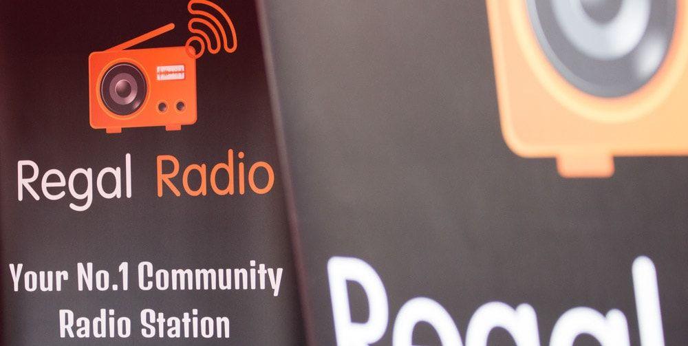 Two floor-standing banners advertising Regal Radio.